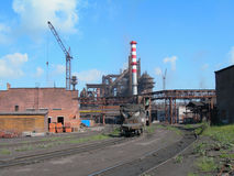 Metallurgical works with blast furnaces. Chimney flue and railway in Russia Royalty Free Stock Photography