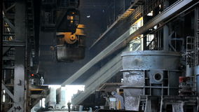 Metallurgical works. Ladle full of molten metal transportation at steel mill stock video footage