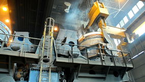 Metallurgical works. Ladle full of molten metal transportation at steel plant stock video footage