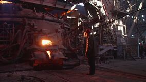 Metallurgist Job Worker In A Steel Plant Hot Molten Metal Pouring. Blast Furnace Steel Production Steel Works. Pouring