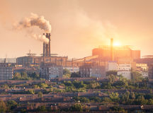 Metallurgy plant at sunset. Steel mill. Heavy industry factory. Steel factory with smog. Pipes with smoke. Metallurgical plant in city. steel, iron works royalty free stock photography