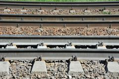 Metals on rail track. Shot of metals and sleeper on rail road track Stock Photos