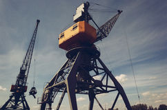 Metals recycling cranes. With metal claws Stock Images