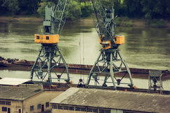 Metals recycling cranes. On the riverbank Stock Photo