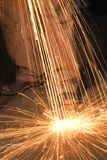 Metalsmith creating sparks. Stock Photography