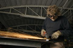Metalsmith creating sparks. Royalty Free Stock Photos