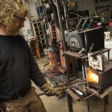 Metalsmith heating metal. Royalty Free Stock Photo
