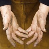 Metalsmith's hands. Royalty Free Stock Photos