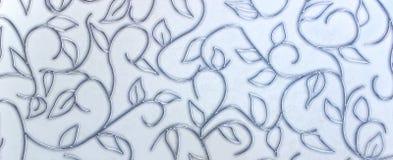 Metalu liścia dekoracja na kamiennej ścianie Zdjęcie Royalty Free