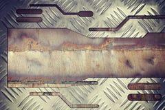 Metalu talerz na spawalniczego szwu starym żelaznym tle Zdjęcia Stock