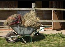 Metalu Wheelbarrow pełno haynets Obrazy Royalty Free
