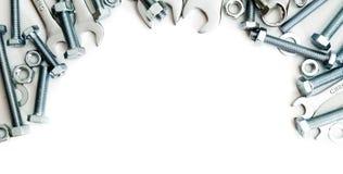 metalwork Metallfast tillbehör, skruvnyckel på en vit royaltyfria foton