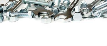 metalwork Metallfast tillbehör, skruvnyckel på en vit Fotografering för Bildbyråer