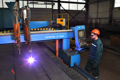 Metalwork Plant, worker controls system thermal cutting of metal Royalty Free Stock Photo