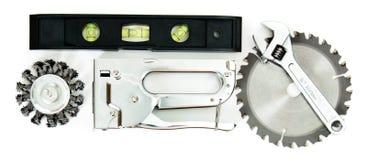metalwork Scie, clé et d'autres outils sur le blanc image stock