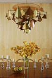 Metalworked Light Above Dining Table Stock Photo