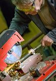 Metalworker cutting metal Stock Images