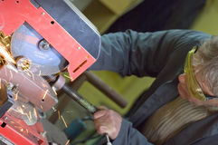 Metalworker cutting metal stock image