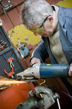 Metalworker cutting metal stock photos