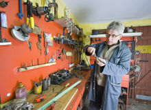 Metalworker and his tools Royalty Free Stock Photography