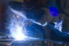 Metalworker in his workshop. Welding a gate Royalty Free Stock Photos