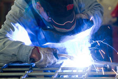 Metalworker in his workshop. Welding a gate Stock Images