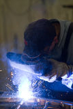 Metalworker in his workshop. Welding a gate Royalty Free Stock Photography