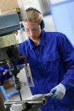 Metalworker making holes Royalty Free Stock Photography