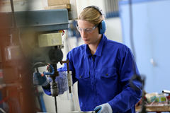 Metalworker making holes in steel Stock Photography