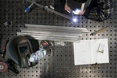 Metalworker welding metal pieces Royalty Free Stock Image