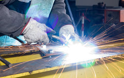 Metalworker with sparkles Royalty Free Stock Photos