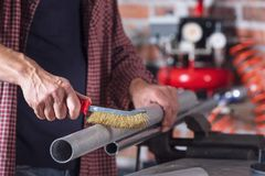 Free Metalworker Using A Hand Metal Brush Royalty Free Stock Image - 161103456