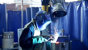 Metalworker Welder operates with metall sheet. HD stock footage