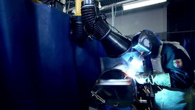 Metalworker Welder operates with metall sheet. stock video footage