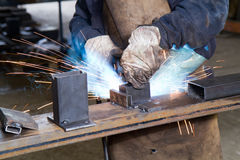 Metalworker at work. In his workshop Royalty Free Stock Photography