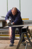 Metalworker at work. In his workshop Royalty Free Stock Photos