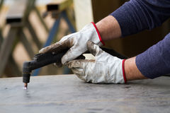 Metalworker at work Stock Photos