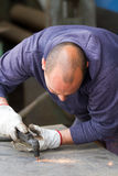 Metalworker at work. In his workshop Royalty Free Stock Image