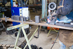 Metalworker at work. In his workshop Royalty Free Stock Photo