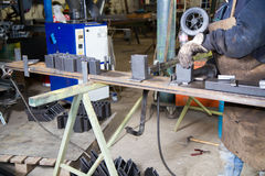Metalworker at work. In his workshop Royalty Free Stock Images