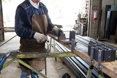 Metalworker at work. In his workshop Stock Image