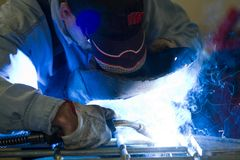Metalworker at work. With an iron gate Royalty Free Stock Images