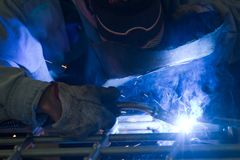 Metalworker at work. With an iron gate Royalty Free Stock Photos