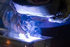 Metalworker at work. In a workshop Stock Photo