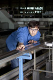 Metalworker working in fabric Stock Images