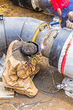 Metalworker working on a pipeline Stock Images
