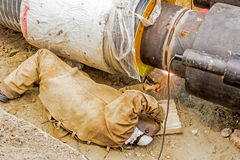 Metalworker working on a pipeline Stock Photography