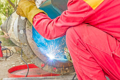 Metalworker working on a pipeline Royalty Free Stock Images