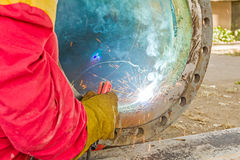 Metalworker working on a pipeline Stock Image