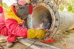 Metalworker working on a pipeline Royalty Free Stock Photo
